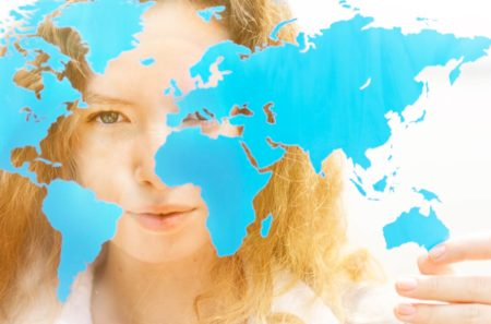 Young girl holding world map